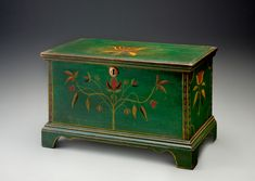 """The Rick & Terry Ciccotelli Folk Art Collection - Child's Size Paint-Decorated Lift-Top Chest Inscribed to Granville H. Pool, Grayson County, Virginia, Circa 1822-1830 - Poplar, original painted decoration, 10 1/2 x 17 1/2 x 9 inches. The underside of the lid bearing the painted inscription """"Granville H. Pool"""" within a border composed of red & green dashes."""