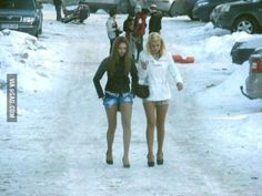Winter in Romania. Either those are a couple of really hardy women (I like) or they are robots / Illuminati.