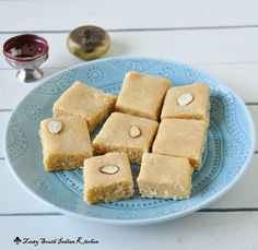 Delicious gluten free fudge   7 cup burfi from southern part of India. Easy to make you need only besan/chickpea flour, coconut, almond meal, sugar, milk and ghee  spiced with cardamom.