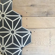 I LOVE THIS! Just love how the Tess III hex pattern is interwoven with the reclaimed wood! The Tess cement tile is stocked in several colors.