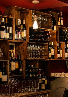 Wooden wine bar shelving made from wine boxes at Cellar Magneval, Woking, Surrey