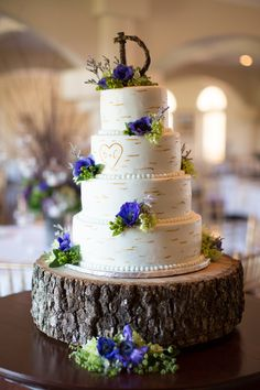 Birch bark, woodland inspired wedding cake brings the outside in at an elegant vineyard affair by North Star Events. Gayle Driver Photography