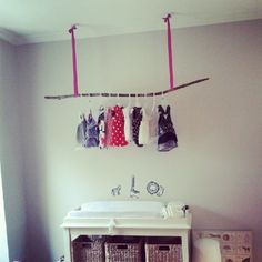 Hang clothing from a makeshift tree branch if no closet is available.