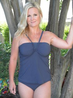 I like this bathing suit. Curvy Girl Guide shows real (and BRAVE) women in bathing suits to help you pick a style.