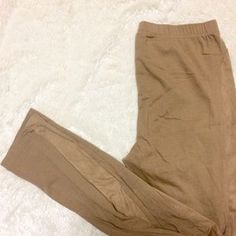 I just discovered this while shopping on Poshmark: Light brown leggings. Check it out! Price: $8 Size: S