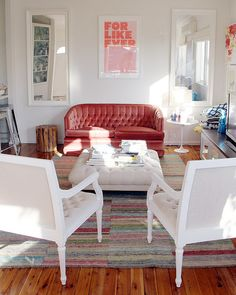 Red velvet couch. Temporary armchairs by ishandchi, via Flickr