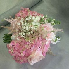 Gorgeously fragrant bouquet with pale pink roses, hydrangea and astilbe, with heavenly stocks and sprigs of gypsophila