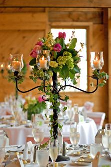 Candelabra centerpiece with ivy, hydrangea. & tulips.