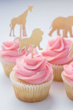 Feast your eyes on this amazing boho African Wild One! The pink cupcakes topped with gold safari animal silhouettes are fantastic! See more party ideas and share yours at CatchMyParty.com