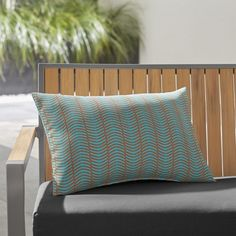 Shop Boomerang Outdoor Lumbar Pillow.  Boomerang-shaped lozenges in bright blue stripe back and forth to give this outdoor pillow optic punch.