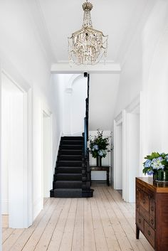 Cheap Home Decor Natural wood floors mixed with white walls and black staircase in this Historic Australian Home Renovation by SJB Black Wood Floors, Natural Wood Flooring, Wood Walls, Wood Wood, Rustic Wood, Black Floorboards, Diy Wood, Black Staircase, Staircase Design