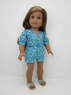 Turquoise and gray romper by JazzyDollDuds on Etsy. Made following the Wrap Romper pattern, available here https://www.pixiefaire.com/products/wrap-romper-18-doll-clothes. #pixiefaire #wrapromper