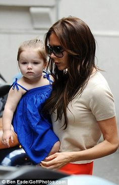 My office is a creche: Mrs Beckham said Harper plays on a swing in the office of her fashion label