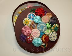 Box decorated with a variety of hand worked passementerie buttons