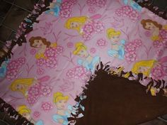 large handmade princess blanket  with brown backing for that precious little girl ...so sweet and soft ..fleece materials
