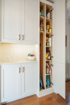 Broom storage and cubbies for pantry items.