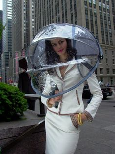 Nubrella Hands Free Umbrella is actually an umbrella with a space age bubble that covers the head and shoulders from rain, sun and wind.