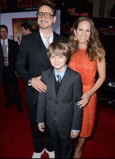 HOLLYWOOD, CA - APRIL 24: Actors Robert Downey Jr., Ty Simpkins, and Susan Downey arrive at the premiere of Walt Disney Pictures Iron Man 3 at the El Capitan Theatre on April 24, 2013 in Hollywood, California. (Photo by Kevin Winter/Getty Images) 2013 Getty Images please follow me,thank you i will refollow you later