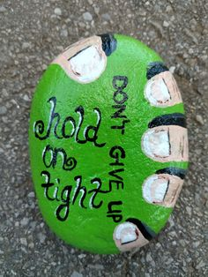 Hold on tight, don't give up rock painting