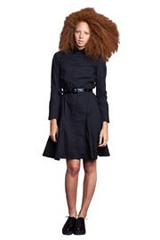 belted coat...bare legs...black oxford shoes!