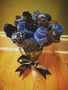 Men's Sock Bouquet. Perfect for a birthday gift, Sweetest Day, or even an anniversary. A little something with some love put into it! Great idea!! #boyfriendbirthdaygifts