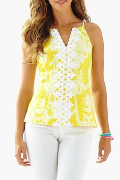 The Magnolia top is a fitted halter top with lace details. This super flattering neckline is classic and elegant. Wear this yellow printed Magnolia with white denim for a night out with your love.   Magnolia Halter Top by Lilly Pulitzer. Clothing - Tops - Sleeveless Sandestin Golf and Beach Resort Florida