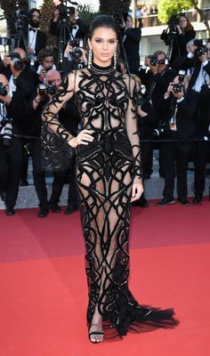 "Beautiful Kendall Jenner turns heads wearing a ‪#‎CavalliCouture‬ by ‪#‎PeterDundas‬ long t-shirt dress in silk tulle all-over embroidered with intertwined black velvet and gold lurex snakes on the red carpet of the ""From Land of the Moon"" during the 69th ‪#‎CannesFilmFestival‬."