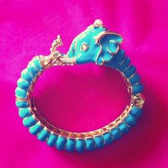 Kenneth Jay Lane elephant bangle...I mean who isn't partial to exotic animal bling?