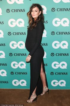 Sexy mama: Nicole changed it up in the evening, donning a full-length black long sleeved d...