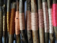 Threads of various colors and textures wrapped around driftwood . . . so simple and incredibly lovely.