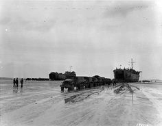 LST-72 and LST-325 unloading directly onto trucks after being left 'high and dry' by the tide at Morlaix, France, 5 September 1944 (US National Archives)