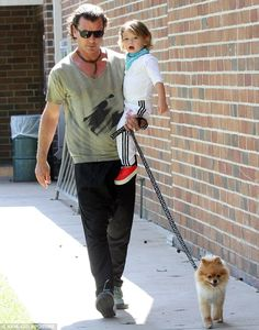 Staying close: Gavin carried his youngest, Apollo, as well as their pup's leash, while heading to the park Blake Shelton Kids, Gavin Rossdale, Kids Choice Award, Gwen Stefani, Three Kids, New Man, Kingston, Apollo