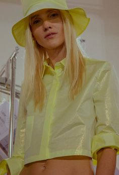 Shiny acid yellow cropped jacket and matching bucket hat. 90s rave inspired party vibes. Iceberg backstage SS16