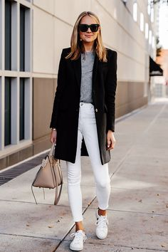 7 Ways You Can Wear White Jeans In Winter: Fashion blogger 'Fashion Jackson' wearing a black coat, a grey sweater, white skinny jeans, white sneakers, a beige flap bag and black square sunglasses. Winter outfit, winter style, winter fashion, fashion trends 2019, winter fashion 2019, white jeans outfit, #winterstyle #teddycoat #fashion2019 #casualstyle #ootd #bloggerstyle