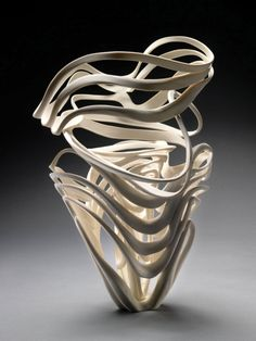 Echo Vase, 2009; Jennifer McCurdy; porcelain, wheel-thrown, altered, carved, incised, and burnished; 14 x 11 x 9 in. Photo: Gary Mirando at the Sherrie Gallerie in Columbus, OH