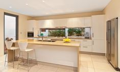 Freshwater contemporary open plan kitchen with splashback window