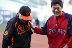 CrowdCam Hot Shot: Boston Red Sox relief pitcher Koji Uehara talks with Baltimore Orioles manager Buck Showalter before the start of the game at Fenway Park. Photo by David Butler II