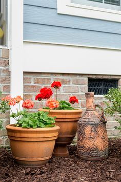 You simply can't go wrong with geraniums in terra cotta pots. It's a classic look that works wonderfully in the patio makeover by Stacey Blake of Design Addict Mom. See her patio decorating ideas on The Home Depot Blog. || @designaddictmom
