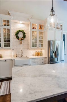 Christmas Decorating Ideas. Kitchen Christmas Decor Ideas #ChristmasDecor #KitchenChristmasDecor Tolaris Homes.