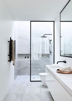 Modern bathroom all white wilt black steel doors to shower