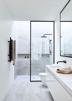 Modern bathroom all white wilt black steel doors to shower