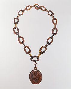 Locket and Chain. Made from tortoiseshell. circa 1870.