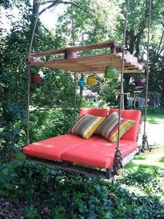 Here is another pallet wood patio swing which is nice and simple and has a beautiful wooden shade which makes it unique and purposeful. The base of the swing and the recliners are perfect to enjoy the surroundings. The hanging colorful lamps are adding to the beauty of your surroundings.