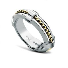 Asprey: this gorgeous white gold ring with yellow gold rope is a lovely band for any special occasion.