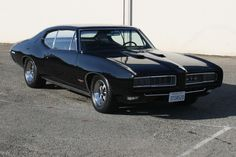 Black 1968 GTO with the optional Hide-away Headlamps.