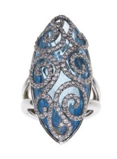 Editor's Picks from the Elizabeth Taylor Auction | Arab Women Now. Diamond and gold ring set with marquise-cut light blue gemstone enhanced by circular-cut diamond scrolls, mounted in 18k gold.