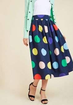 70 <p>You're certain to make a gal pal date totally stylish by donning this navy blue skirt for an afternoon of noshing noodles and nattering! With a gathered waist and a fun print of large, multicolored polka dots, this midi displays just as much good taste as the delicious bowl before you.</p>