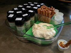 A make-your-own-dip station in the cool-n-serve. Equal parts mayo & sour cream, pretzel sticks and little cups! Excellent idea to try out pantry rubs and seasonings.