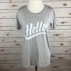 """[J. Crew] Hello Graphic Tee Shirt Casual Cool Chic Say hello to your new favorite graphic tee! Super soft. Crew neck. Slightly loose fit.  Color: Gray & White Fabric: 55% Cotton 35% Polyester 10% Viscose Size: XS (could probably fit a Small) Bust: 18"""" Length: 24"""" Condition: EUC. No flaws.  No Trades! J. Crew Tops Tees - Short Sleeve"""