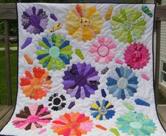 Rita McCart's quilt has taken a traditional motif, the Sunflower or Aster, and made it bloom!   It's so colorful and we love how there are random petals flying around.  It's fun to see the free arrangement and variance of size, too.  24blocks.com